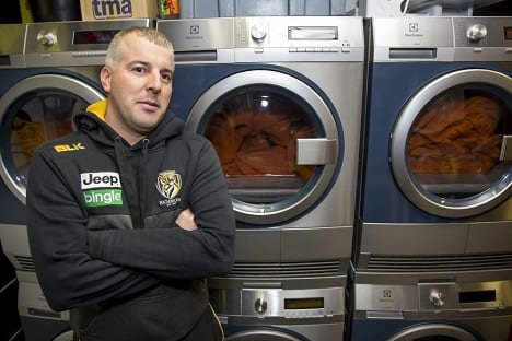 Footballer_Standing_In_Front_Of_WashingMachines