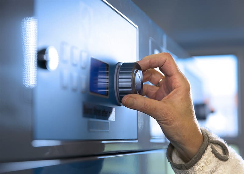 Programvælger på maskine i bolivaskeri