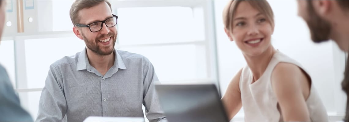 People over computer for working together